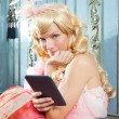 Blond fashion princess woman reading ebook tablet — Stock Photo