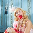 Blond fashion princess eating apple funny expression — Stock Photo