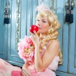 Stock Photo: Blond fashion princess eating apple with flowers dress
