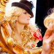 Fashion blond woman with hat in baroque golden mirror — Stock Photo