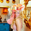 Blond fashion woman with spring flowers hat — Stock Photo