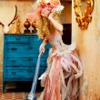 Baroque fashion blonde housewife vacuum cleaner - Stock Photo