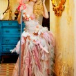 Stok fotoğraf: Baroque fashion blonde housewife wommop chores