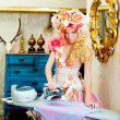 Royalty-Free Stock Photo: Baroque fashion blonde housewife woman iron chores