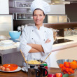 Chef woman portrait in the kitchen — Stock Photo