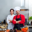 Chef couple man and woman posing in kitchen — Stock Photo
