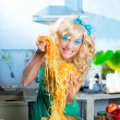 Blonde fashion funny on kitchen with pasta and — Stock Photo