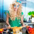 Stock Photo: Blonde fashion funny on kitchen with pasta and
