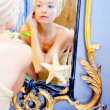 Beauty woman with towel looking at golden mirror — Stok fotoğraf