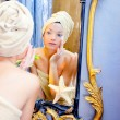 Beauty woman with towel looking at golden mirror — Foto de Stock