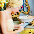 Female in bathroomreading ebook tablet — Stock Photo #8702975