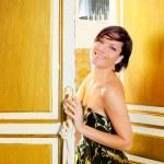 Elegance fashion woman in hotel room door — Stock Photo