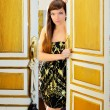 Elegance fashion woman in hotel room door — Stock Photo