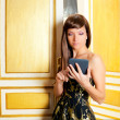 Elegance fashion woman reading ebook tablet in a door — Stock Photo