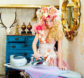 Baroque fashion blonde housewife woman iron chores — Stock Photo