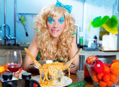 Blonde funny on kitchen with pasta hungry — Stock Photo