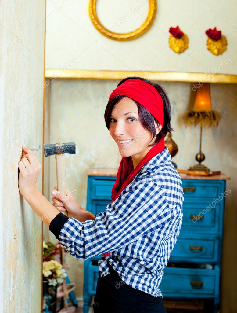 Diy fashion woman with nail and hammer on grunge house — Stock Photo #8701907