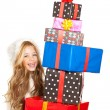 Kid little girl with christmas present gifts stacked — Stock Photo #8802925