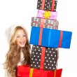 Kid little girl with christmas present gifts stacked — Stock Photo #8802940