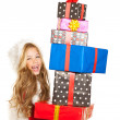 Kid little girl with christmas present gifts stacked — 图库照片
