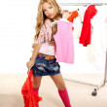 Fashion victim kid girl at backstage wardrobe — Stock Photo