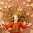 Autumn fall little blond girl on dried tree leaves — Stock Photo #8804678