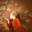 Autumn girl on dried leaves blowing wind lips — Stock Photo #8805367