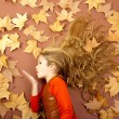 Autumn girl on dried leaves blowing wind lips — Stock Photo #8805411