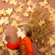 Autumn girl on dried leaves — Stock Photo