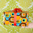 Gift vintage retro present on hand in wallpaper — Stock Photo