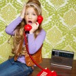 Kid girl retro talking busybody in red telephone - Stock Photo
