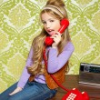 Kid girl retro talking busybody in red telephone — Stock Photo #8806705
