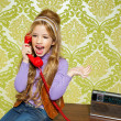 Kid girl retro talking busybody in red telephone — Stock Photo #8806825
