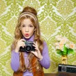 Hip retro little girl shooting photo on vintage camera — Stock Photo