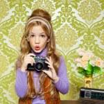 Hip retro little girl shooting photo on vintage camera — Stock Photo