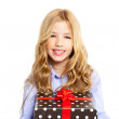 Blond kid girl with present gift red ribbon box - Stock Photo