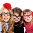 Nerd children girl group with funny glasses — Stock Photo