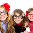 Royalty-Free Stock Photo: Nerd children girl group with funny glasses