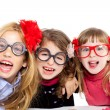 Nerd children girl group with funny glasses - Stock Photo