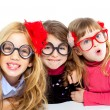 Foto Stock: Nerd children girl group with funny glasses