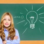 Kid student girl on green school blackboard — Stock Photo