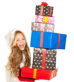 Kid little girl with christmas present gifts stacked — Stock Photo