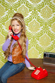 Kid girl retro talking busybody in red telephone — Stock Photo