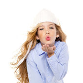 Beautiful winter kid girl blowing wind with lips — Stock Photo