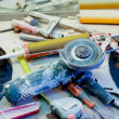 Home improvement  messy clutter with dusted tools - Stock Photo