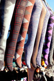 Colorful tights in a row hanging in market — Stock Photo