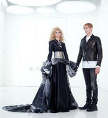 Black haute couture retro futurist couple — Stock Photo