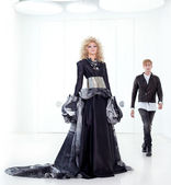 Black haute couture retro futurist couple — Stock Photo