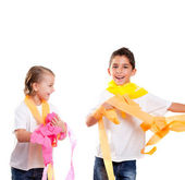 Two children kids in party with colorful paper ribbon — Stock Photo