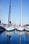 Blue sea boats moored in mediterranean marina — Stock Photo